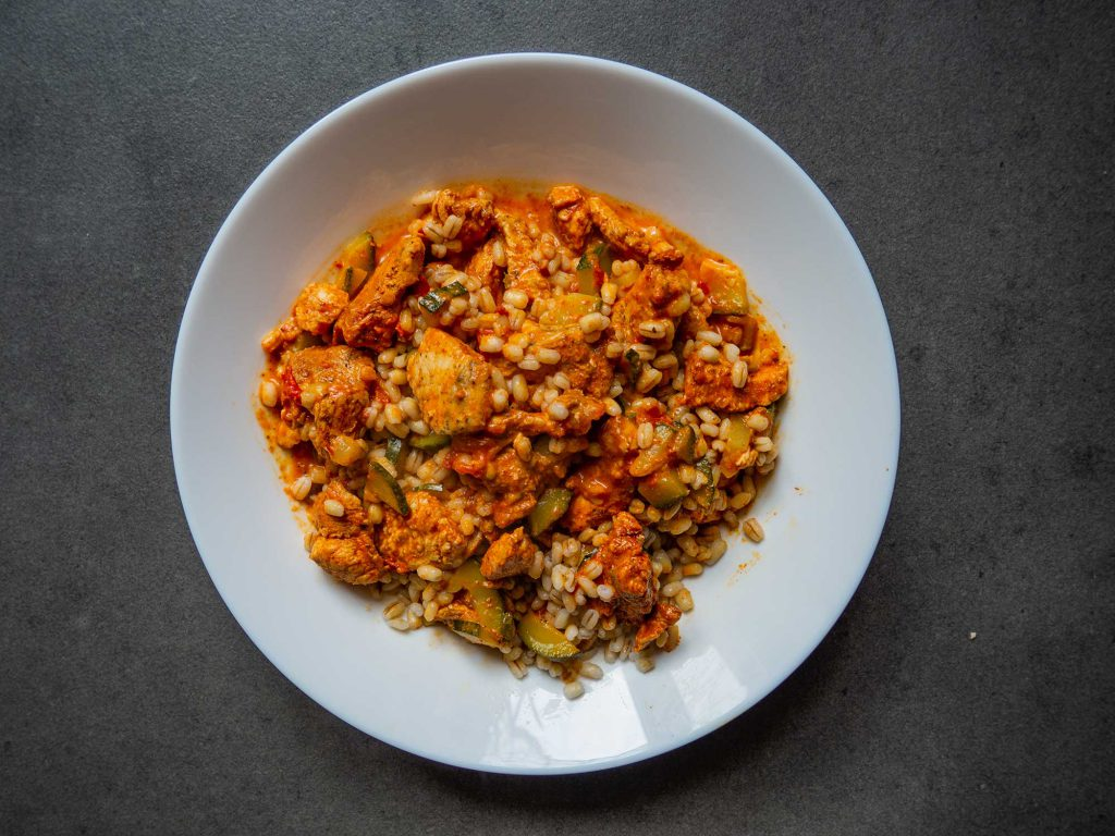Pearl barley with chicken in zucchini and tomato sauce
