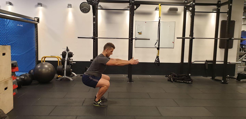 cyclist doing air squat