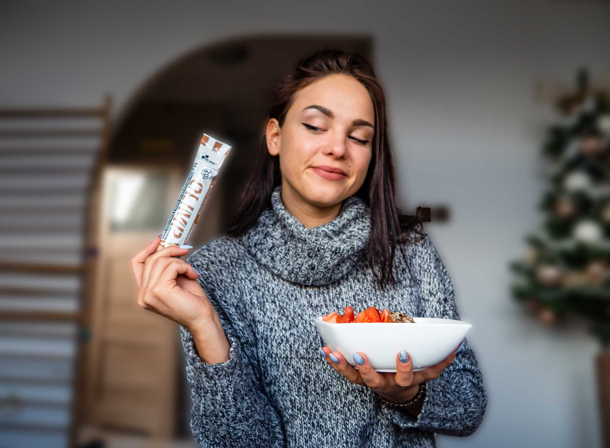 Woman considering snack vs meal