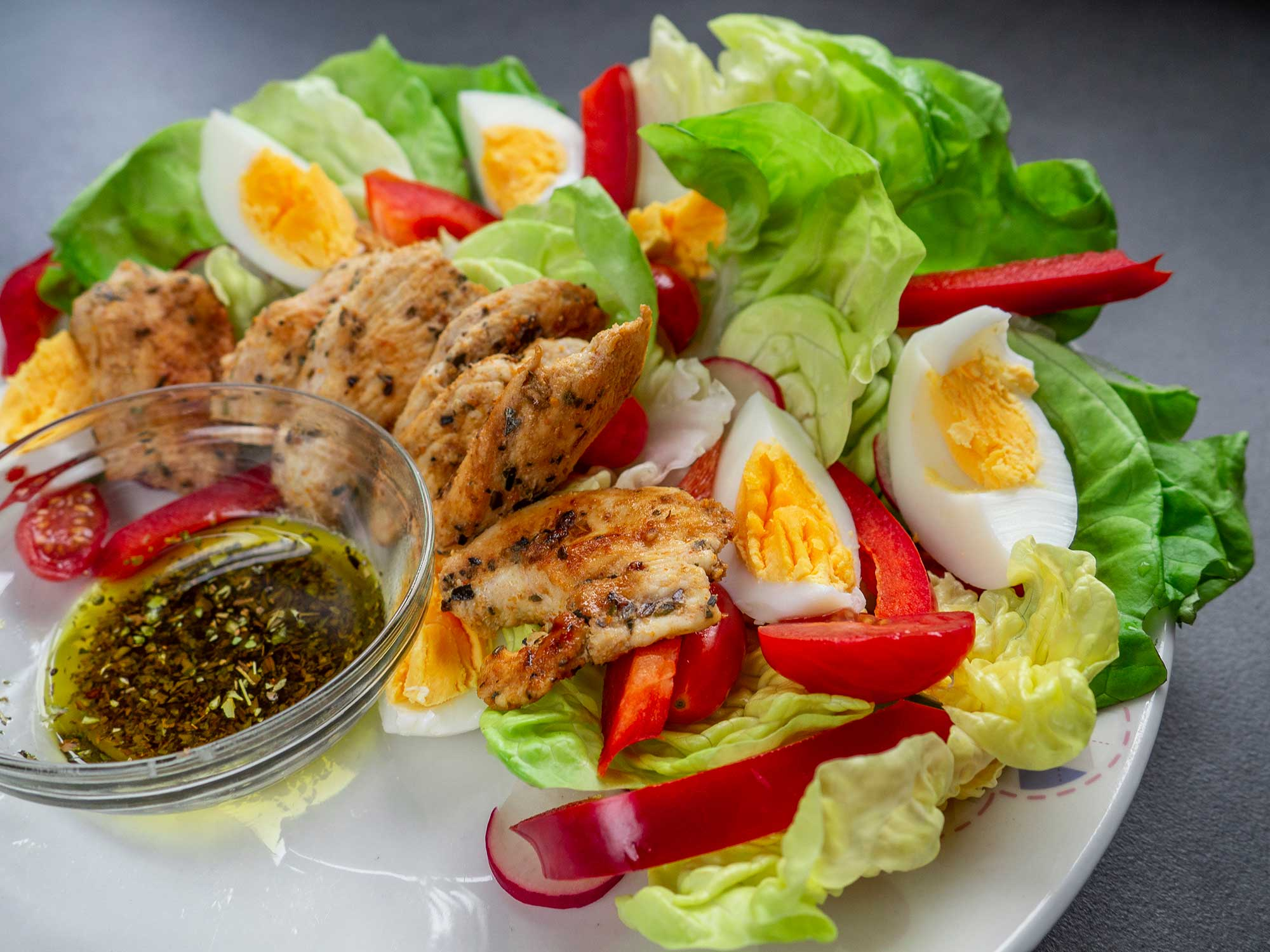 Salad with Grilled Chicken and Eggs preparation serves one