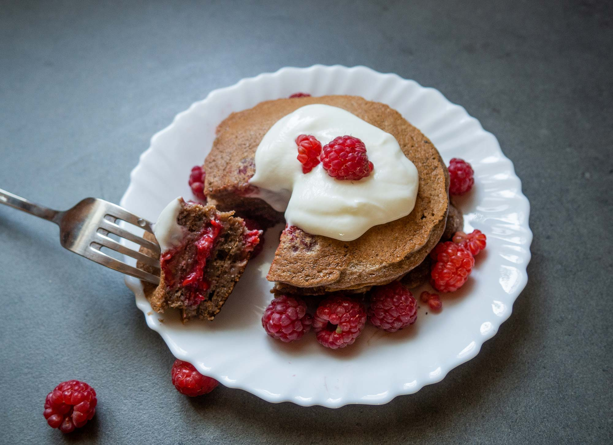 Chocolate pancakes with raspberries ready to go