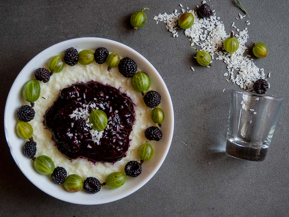 Coconut rice flakes with gooseberries and black raspberries mousse