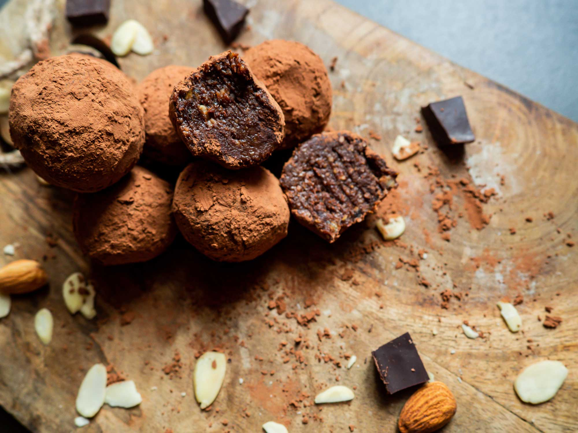 Power balls with dates and almonds sliced in half