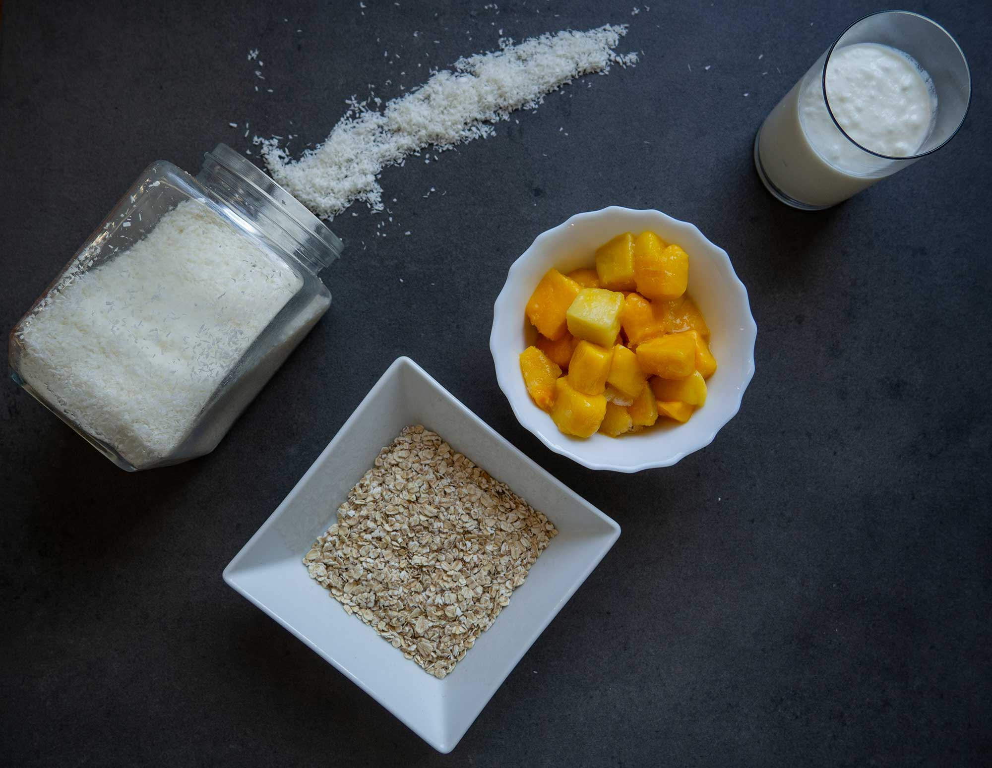mango, oat flakes, coconut flakes, natural yogurt