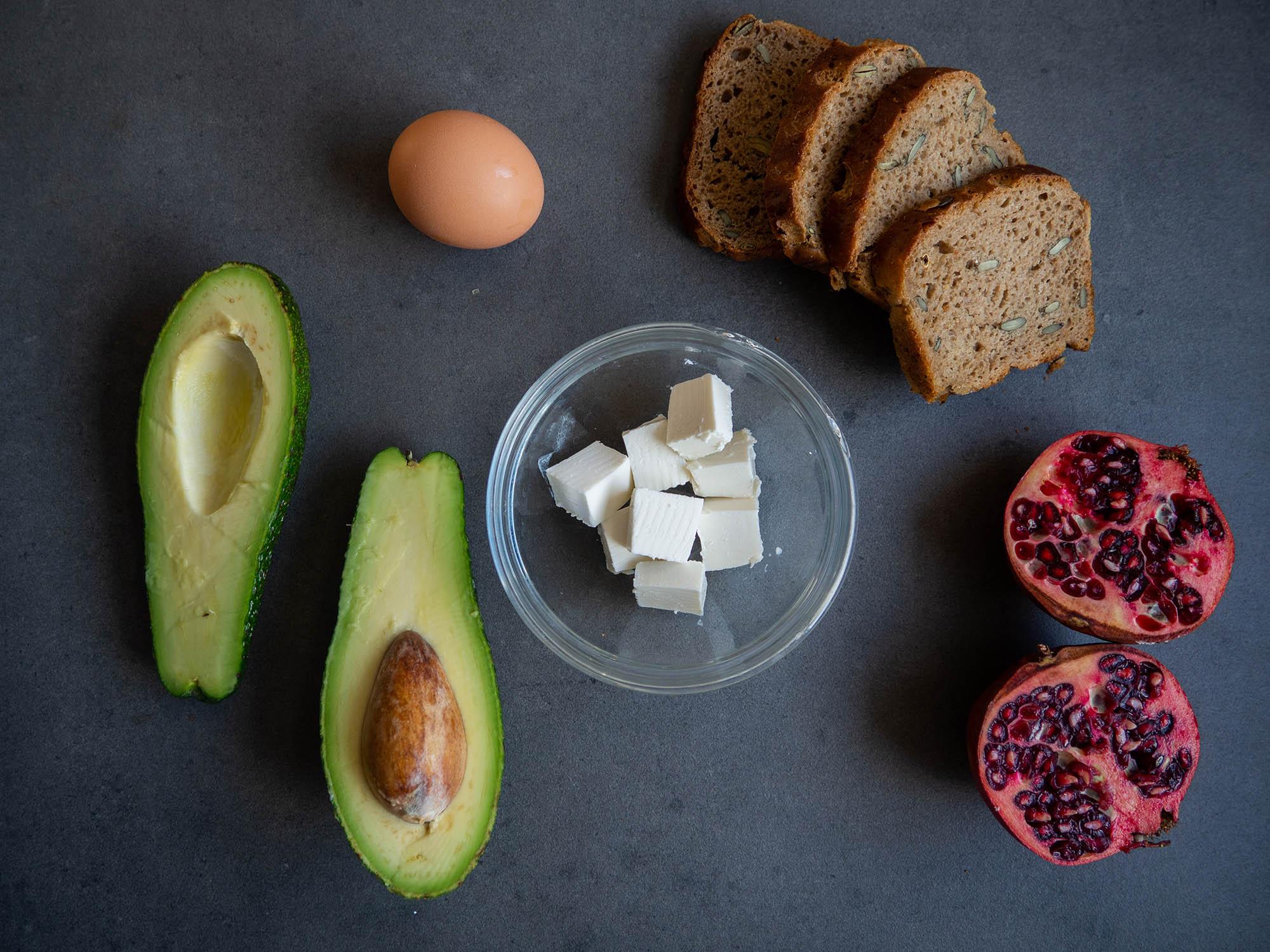 avocado, egg, feta cheese, (4 slices) rye bread, pomegranate